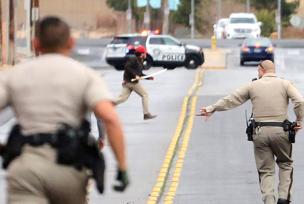 Police chase a man with a samurai sword after a barricade situation at Gilespie Street near East Silverado Ranch Boulevard on Monday, Jan. 9, 2017, in Las Vegas. (Bizuayehu Tesfaye/Las Vegas Revie ...