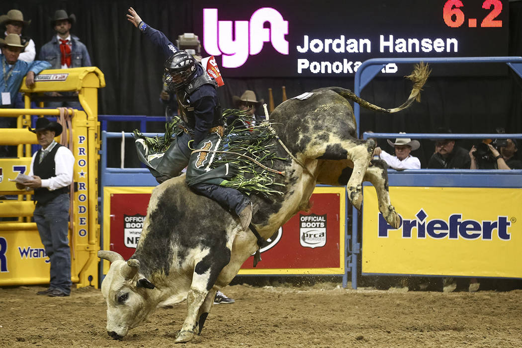 Jordan Hansen of Alberta, Canada rides Tequila in the bull riding competition during the eighth go-round of the National Finals Rodeo, Thursday, Dec. 14, 2017, at the Thomas & Mack Center in L ...