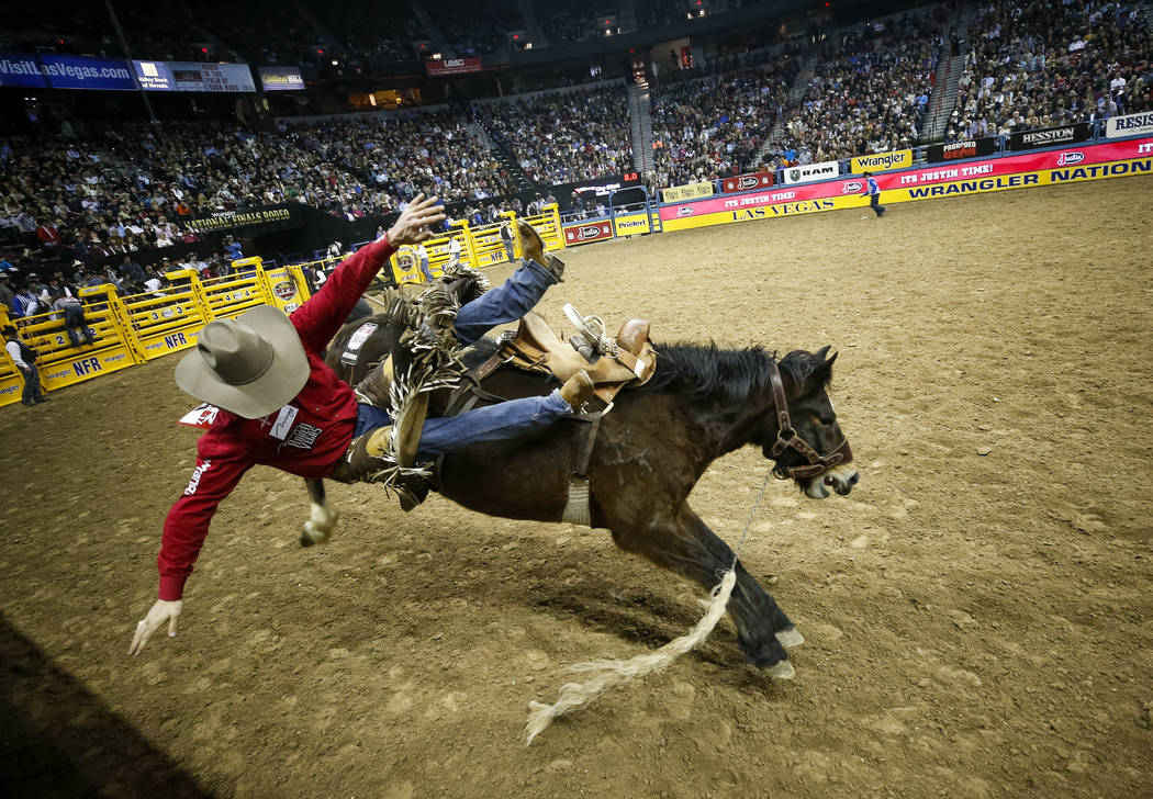 Clay Elliot of Albert, Canada is bucked off Sue City Sue in the saddle bronc riding competition during the eighth go-round of the National Finals Rodeo, Thursday, Dec. 14, 2017, at the Thomas &amp ...