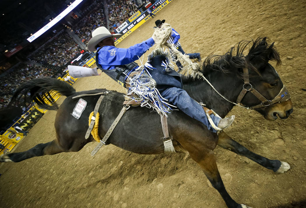 Jesse Wright of Milford, Utah rides Little Sicillia in the saddle bronc riding competition during the eighth go-round of the National Finals Rodeo, Thursday, Dec. 14, 2017, at the Thomas & Mac ...