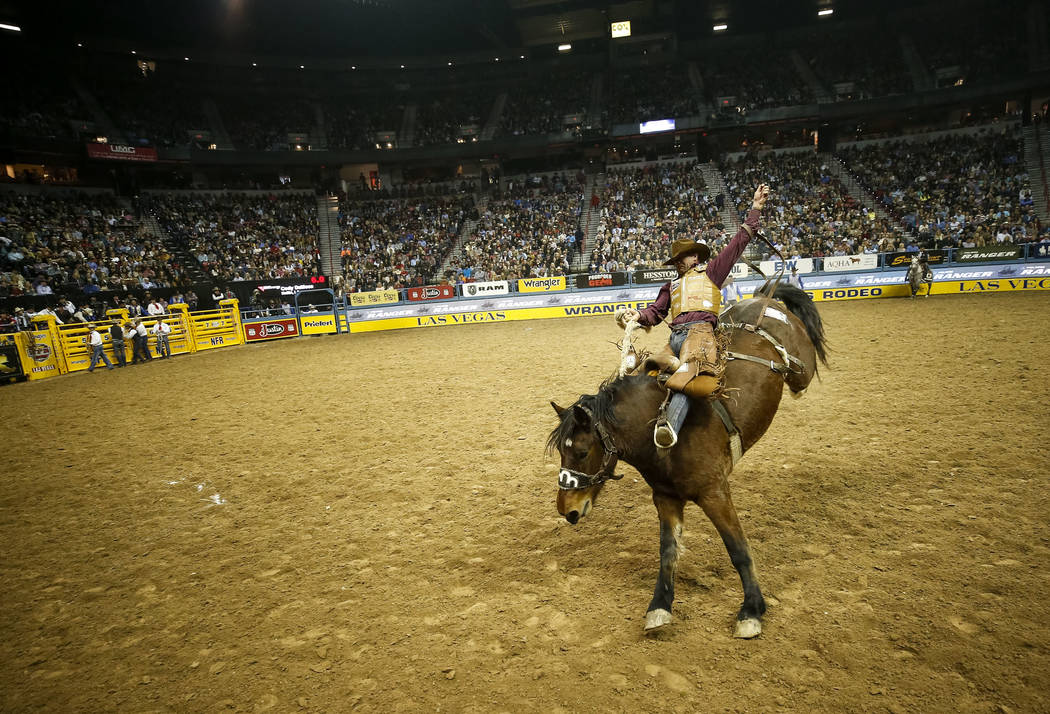 Cody DeMoss of Heflin, Louisiana rides Jumbo Jet in the saddle bronc riding competition during the eighth go-round of the National Finals Rodeo, Thursday, Dec. 14, 2017, at the Thomas & Mack C ...