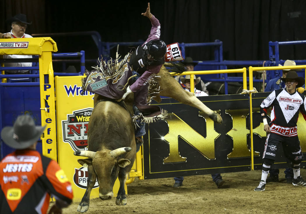 Boudreaux Campbell of Crockett, Texas rides Mo Money in the bull riding competition during the eighth go-round of the National Finals Rodeo, Thursday, Dec. 14, 2017, at the Thomas & Mack Cente ...