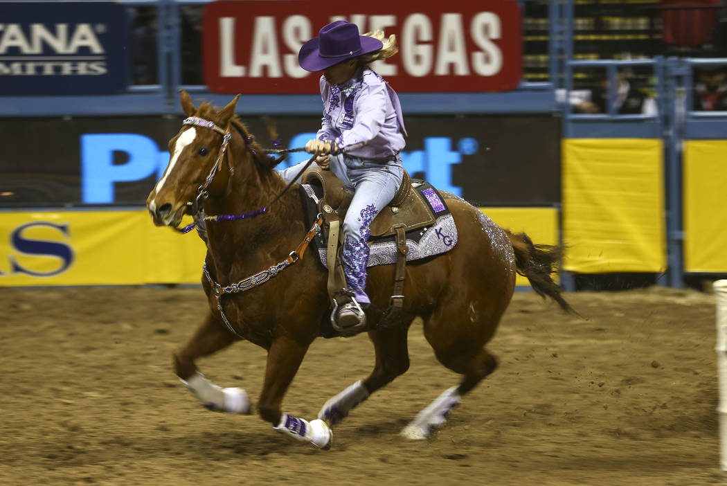 Kathy Grimes of Medical Lake, Washington rides in the barrel racing competition during the eighth go-round of the National Finals Rodeo, Thursday, Dec. 14, 2017, at the Thomas & Mack Center in ...