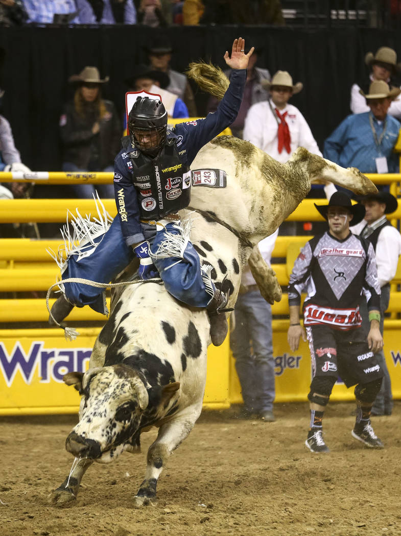 Joe Frost of Randlett, Utah rides Blizzard in the bull riding competition during the eighth go-round of the National Finals Rodeo, Thursday, Dec. 14, 2017, at the Thomas & Mack Center in Las V ...