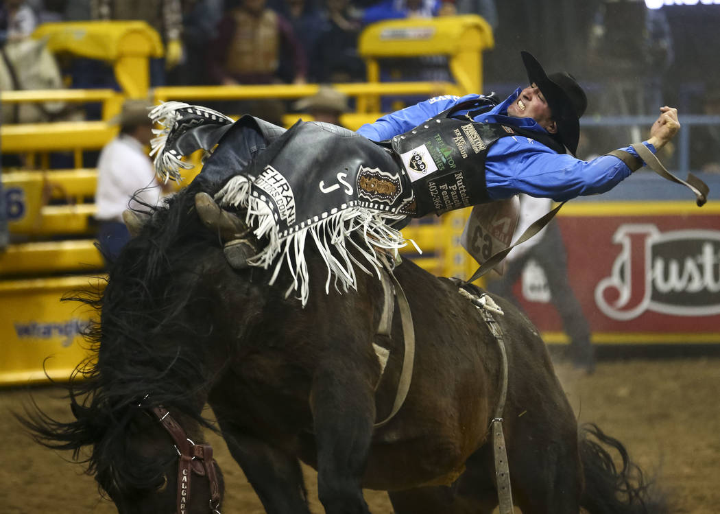 Steven Dent of Mullen, Nebraska rides Special Delivery in the bareback riding competition during the eighth go-round of the National Finals Rodeo, Thursday, Dec. 14, 2017, at the Thomas & Mack ...