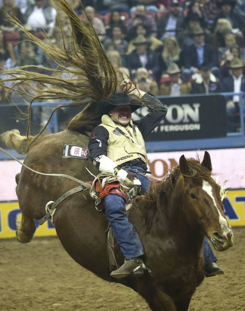 Ty Breuer of Mandan, North Dakota rides Mr. Harry in the bareback riding competition during the eighth go-round of the National Finals Rodeo, Thursday, Dec. 14, 2017, at the Thomas & Mack Cent ...
