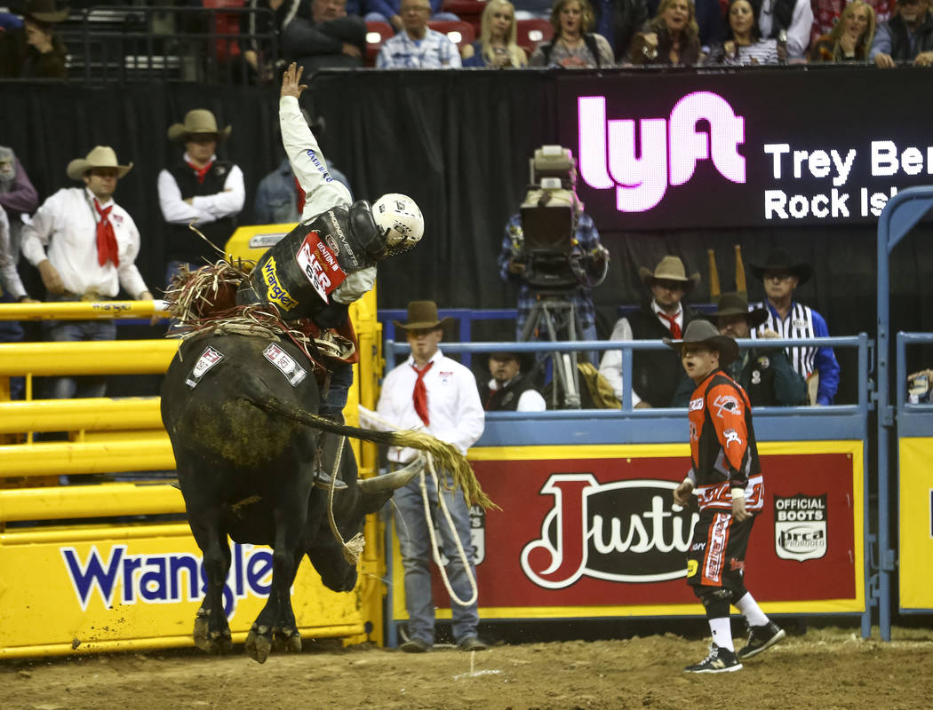 Trey Benton III of Rock Island, Texas rides Pandora's Express in the bull riding competition during the eighth go-round of the National Finals Rodeo, Thursday, Dec. 14, 2017, at the Thomas & M ...