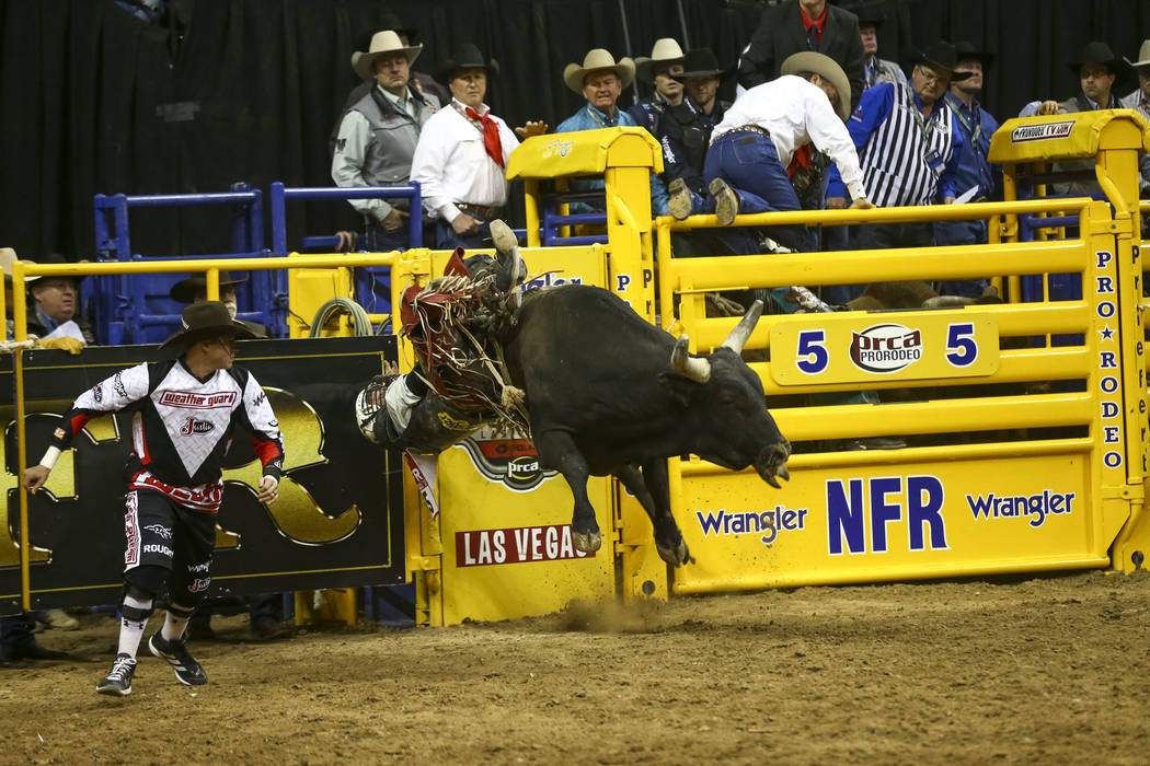 Trey Benton III of Rock Island, Texas get bucked off Pandora's Express in the bull riding competition during the eighth go-round of the National Finals Rodeo, Thursday, Dec. 14, 2017, at the Thoma ...