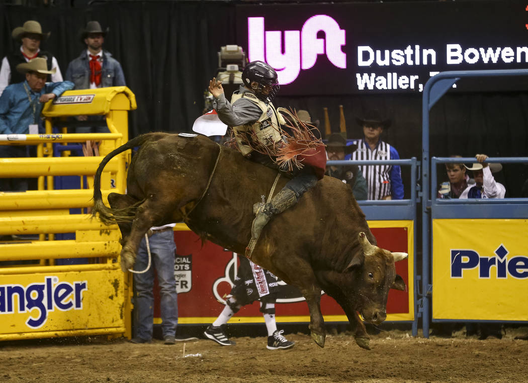 Dustin Bowen of Waller, Texas rides Double Down in the bull riding competition during the eighth go-round of the National Finals Rodeo, Thursday, Dec. 14, 2017, at the Thomas & Mack Center in  ...