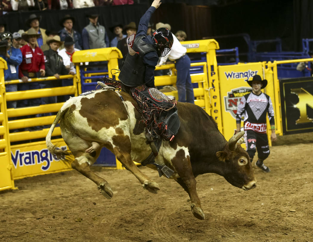 Cole Melancon of Liberty, Texas rides Knock It Off in the bull riding competition during the eighth go-round of the National Finals Rodeo, Thursday, Dec. 14, 2017, at the Thomas & Mack Center  ...