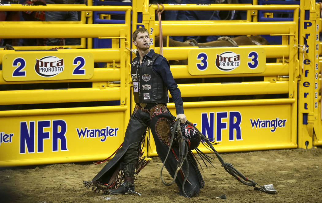 Cole Melancon of Liberty, Texas looks on after riding Knock It Off in the bull riding competition during the eighth go-round of the National Finals Rodeo, Thursday, Dec. 14, 2017, at the Thomas &a ...