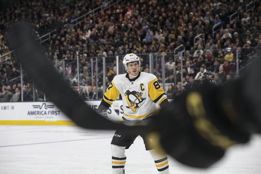 Penguins center Sidney Crosby (87) gets ready for a face off in the second period of Pittsburgh's road matchup with Vegas on Thursday, Dec. 14, 2017, at T-Mobile Arena. The Golden Knights defeated ...