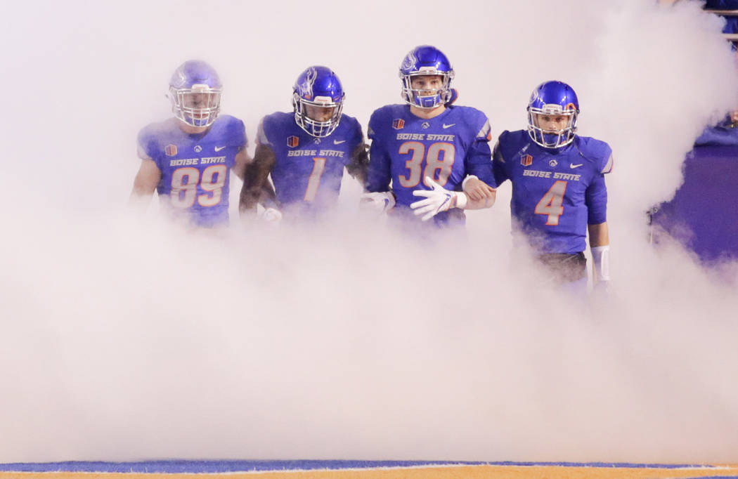 Boise State wide receiver Brock Barr (89), wide receiver Cedrick Wilson (1), linebacker Leighton Vander Esch (38) and quarterback Brett Rypien (4) lead the team onto the field for an NCAA college  ...