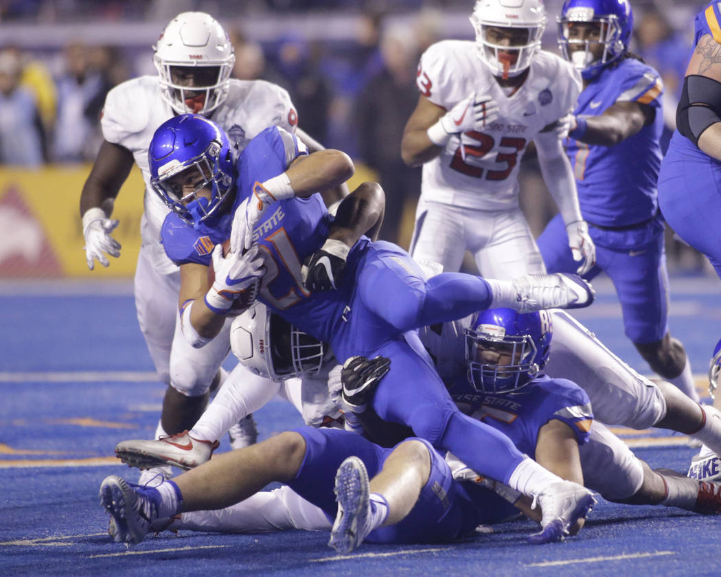 Boise State running back Ryan Wolpin (21) is brought down during the second half of an NCAA college football game against Fresno State for the Mountain West championship in Boise, Idaho, Saturday, ...