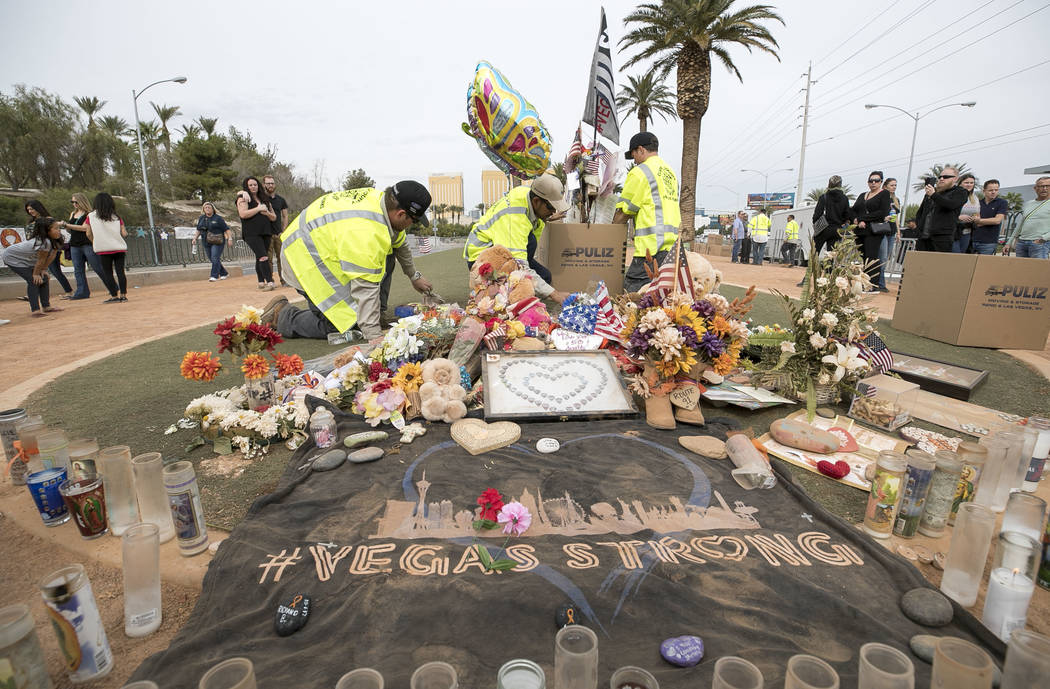 Clark County workers load the remaining crosses of Route 91 Harvest shooting victims following a cross-moving ceremony at a memorial for the victims at the Welcome to Las Vegas sign, Sunday, Nov.  ...