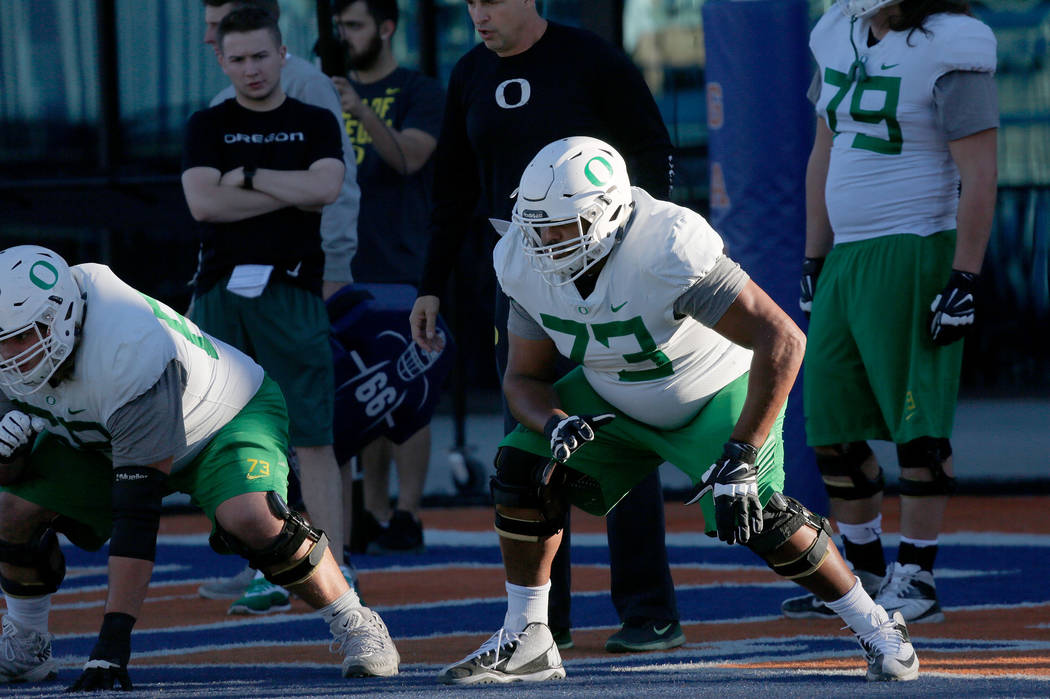 Oregon Ducks offensive lineman Tyrell Crosby (73) during a football practice at Bishop Gorman High School in Las Vegas, Wednesday, Dec. 13, 2017. Oregon Ducks and Boise State Broncos will meet on  ...