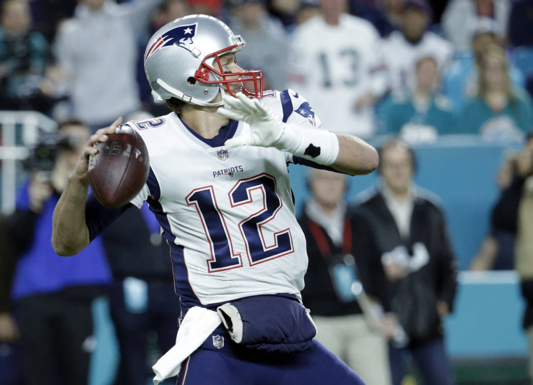 New England Patriots quarterback Tom Brady (12) looks to pass, during the first half of an NFL football game against the Miami Dolphins, Monday, Dec. 11, 2017, in Miami Gardens, Fla. (AP Photo/Lyn ...