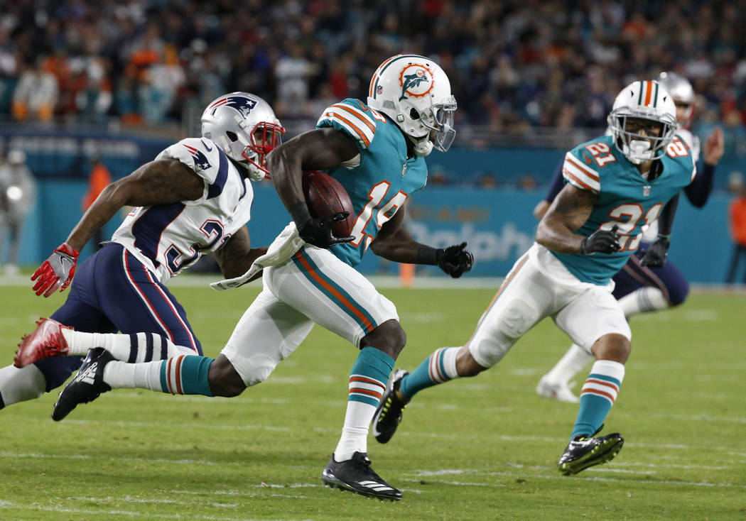 Miami Dolphins wide receiver Jakeem Grant (19) runs ahead ofNew England Patriots cornerback Jonathan Jones (31), during the second half of an NFL football game, Monday, Dec. 11, 2017, in Miami Gar ...