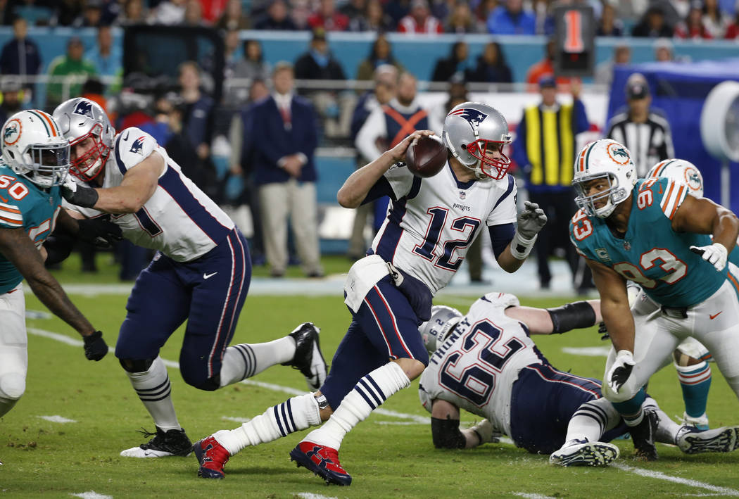 New England Patriots quarterback Tom Brady (12) runs the ball, during the second half of an NFL football game against the Miami Dolphins, Monday, Dec. 11, 2017, in Miami Gardens, Fla. (AP Photo/Wi ...