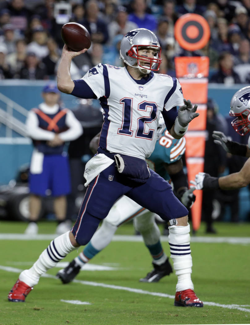 New England Patriots quarterback Tom Brady (12) throws a pass, during the second half of an NFL football game against the Miami Dolphins, Monday, Dec. 11, 2017, in Miami Gardens, Fla. (AP Photo/Ly ...