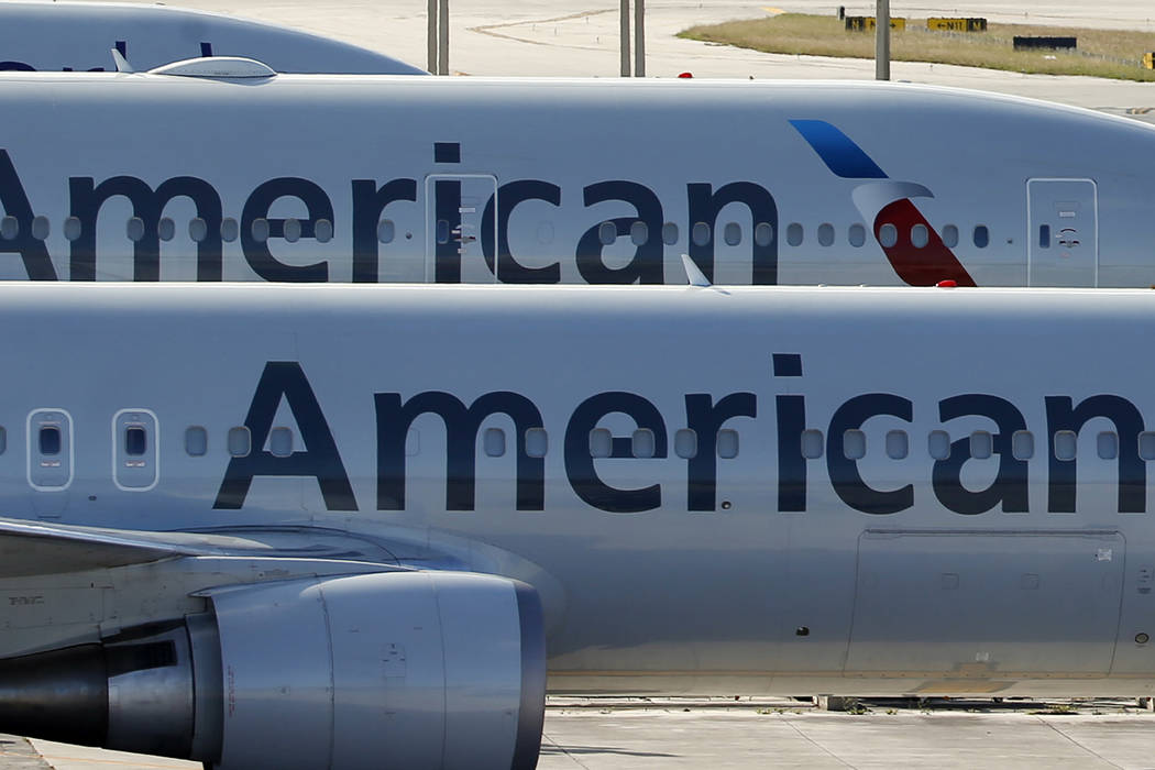 A pair of American Airlines jets are parked on the airport apron at Miami International Airport in Miami, Monday, Nov. 6, 2017. (Wilfredo Lee/AP)