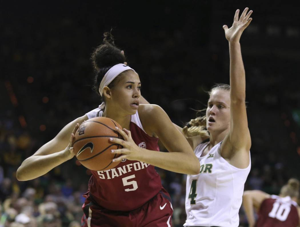 Stanford forward Kaylee Johnson, left, pulls down a rebound next to Baylor guard Kristy Wallace during the first half of an NCAA college basketball game, Sunday, Dec. 3, 2017, in Waco, Texas. (Rod ...