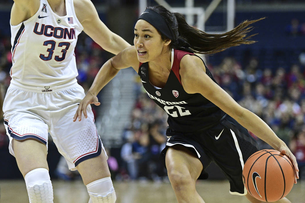 Stanford's Alexa Romano drives on Connecticut's Katie Lou Samuelson during the fourth quarter an NCAA college basketball game, Sunday, Nov. 12, 2017, in Columbus, Ohio. Connecticut won 78-53. (AP  ...