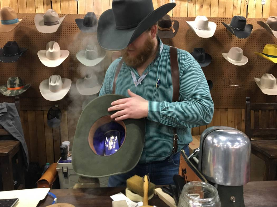 Steam rises up as Tyler Hatley shapes a hat for a customer on Friday at the Flint Boot and Hat Shop booth at the Cowboy Marketplace in the Mandalay Bay Convention Center. Patrick Everson/Special t ...
