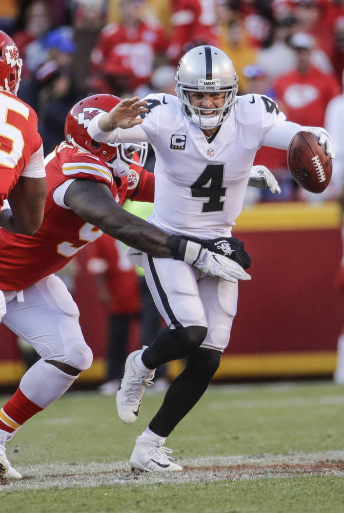 Kansas City Chiefs defensive lineman Rakeem Nunez-Roches (99) sacks Oakland Raiders quarterback Derek Carr (4) during the second half of an NFL football game in Kansas City, Mo., Sunday, Dec. 10,  ...