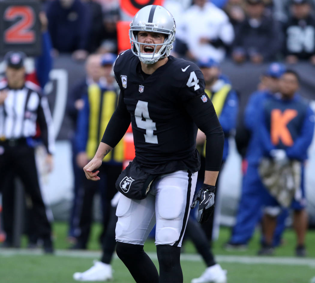 Oakland Raiders quarterback Derek Carr (4) calls for a play on the line of scrimmage during the first half of a NFL game against the Denver Broncos in Oakland, Calif., Sunday, Nov. 26, 2017. Heidi ...