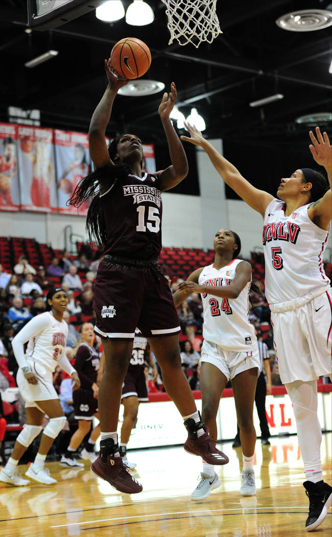 Mississippi State center Teaira McCowan (15) goes for shot against  UNLV forward Simone Sheppard (5) during their NCAA women's college basketball game at Cox Pavilion in Las Vegas, Wednesday, Dec. ...