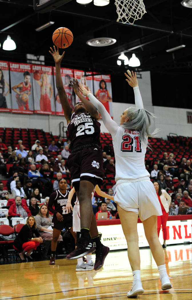 Mississippi State center Zion Campbell (25) goes for shot against UNLV forward Katie Powell (21) during their NCAA women's college basketball game at Cox Pavilion in Las Vegas, Wednesday, Dec. 20, ...