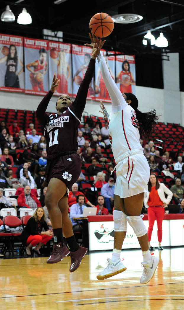 Mississippi State guard Roshunda Johnson (11) goes for shot against UNLV forward Jordyn Bell during their NCAA women's college basketball game at Cox Pavilion in Las Vegas, Wednesday, Dec. 20, 201 ...