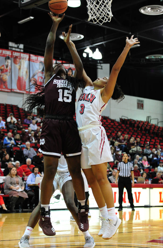 Mississippi State center Teaira McCowan (15) goes for shot against UNLV forward Paris Strawther (3) during their NCAA women's college basketball game at Cox Pavilion in Las Vegas Wednesday, Dec. 2 ...