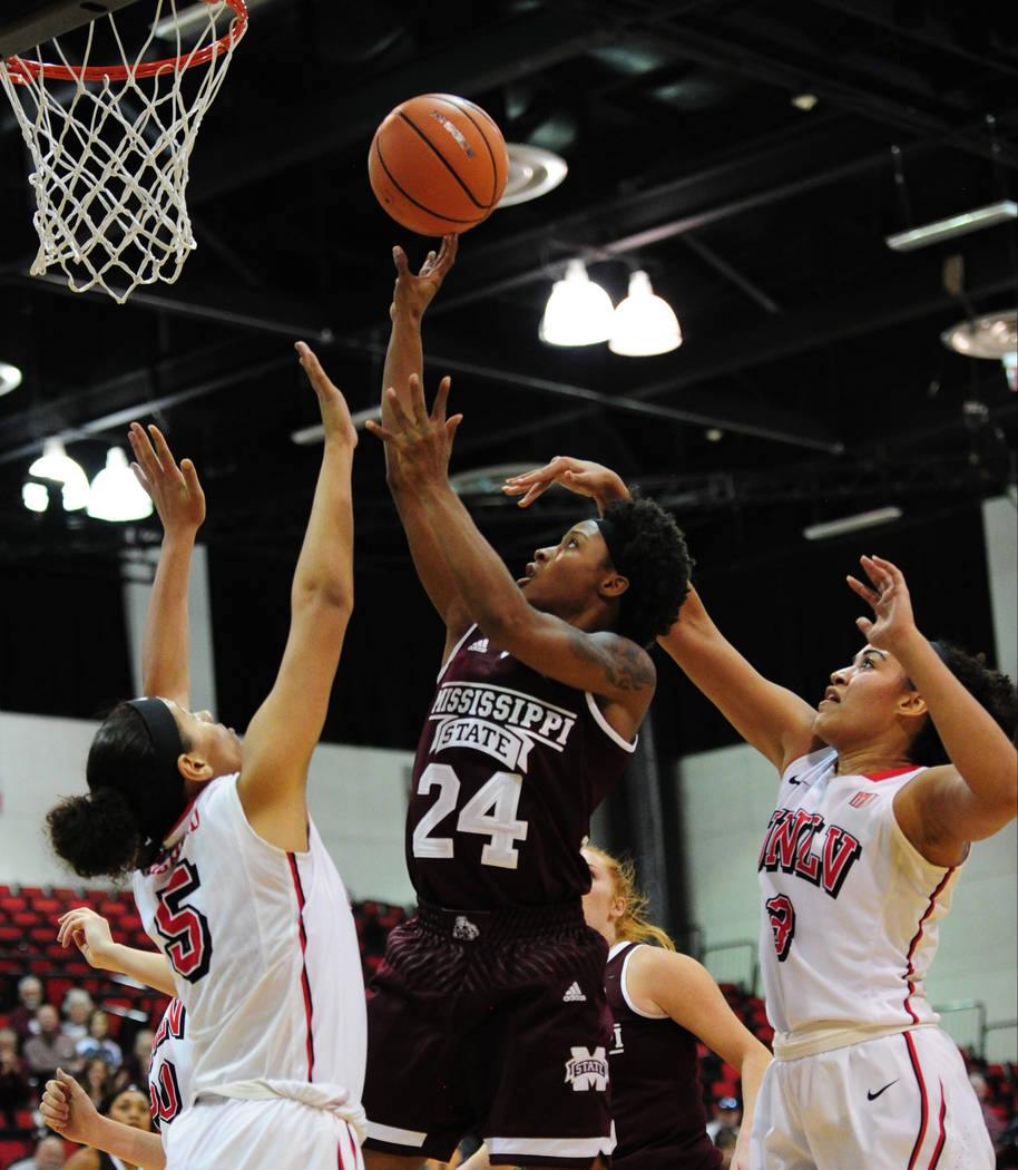 Mississippi State guard Jordan Danberry (24) goes up for a shot against UNLV forwards Simone Sheppard, left, and Paris Strawther during their NCAA women's college basketball game at Cox Pavilion i ...