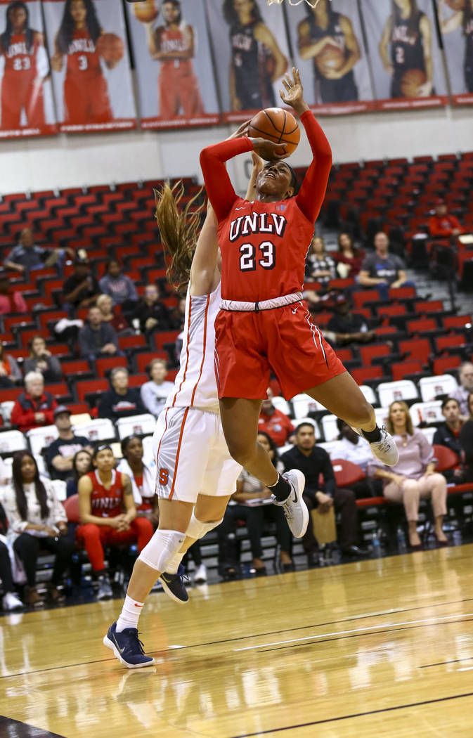 UNLV's Jordyn Bell (23) gets blocked by Syracuse's Digna Strautmane (45) during a basketball game at Cox Pavilion Friday, Dec. 22, 2017, in Las Vegas. Richard Brian Las Vegas Review-Journal @vegas ...