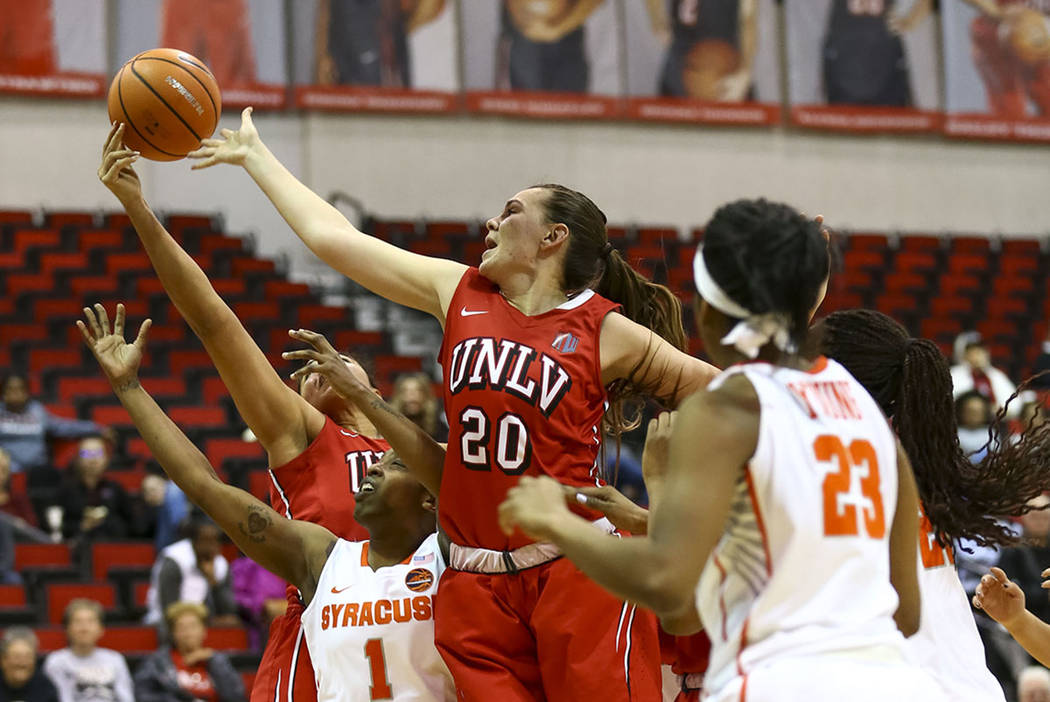 UNLV's Alyssa Anderson (20) and Syracuse's Gabrielle Cooper vie for the rebound during a basketball game at Cox Pavilion Friday, Dec. 22, 2017, in Las Vegas. Richard Brian Las Vegas Review-Journal ...