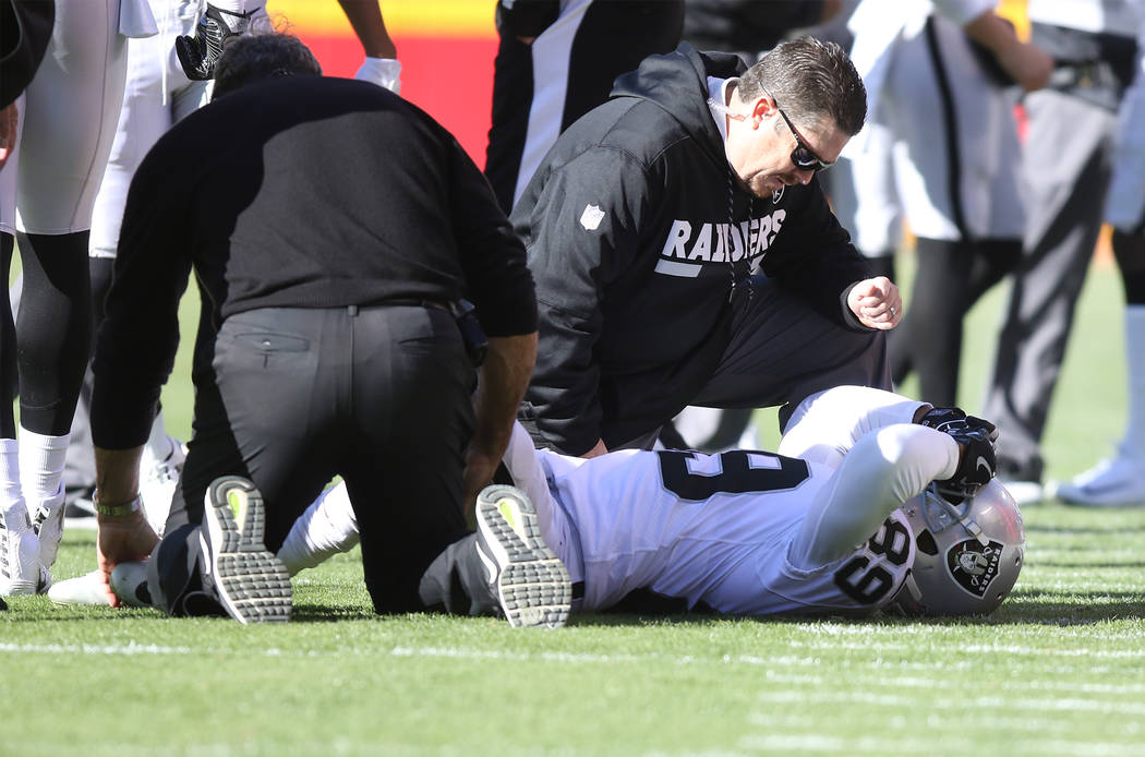 Oakland Raiders wide receiver Amari Cooper (89) is looked at by trainers after being injured on a play during the first half of a NFL game against the Kansas City Chiefs in Kansas City, Mo., Sunda ...