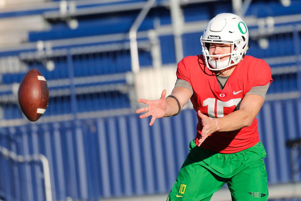 Oregon Ducks quarterback Justin Herbert (10) during a football practice at Bishop Gorman High School in Las Vegas, Wednesday, Dec. 13, 2017. Oregon Ducks and Boise State Broncos will meet on Satur ...