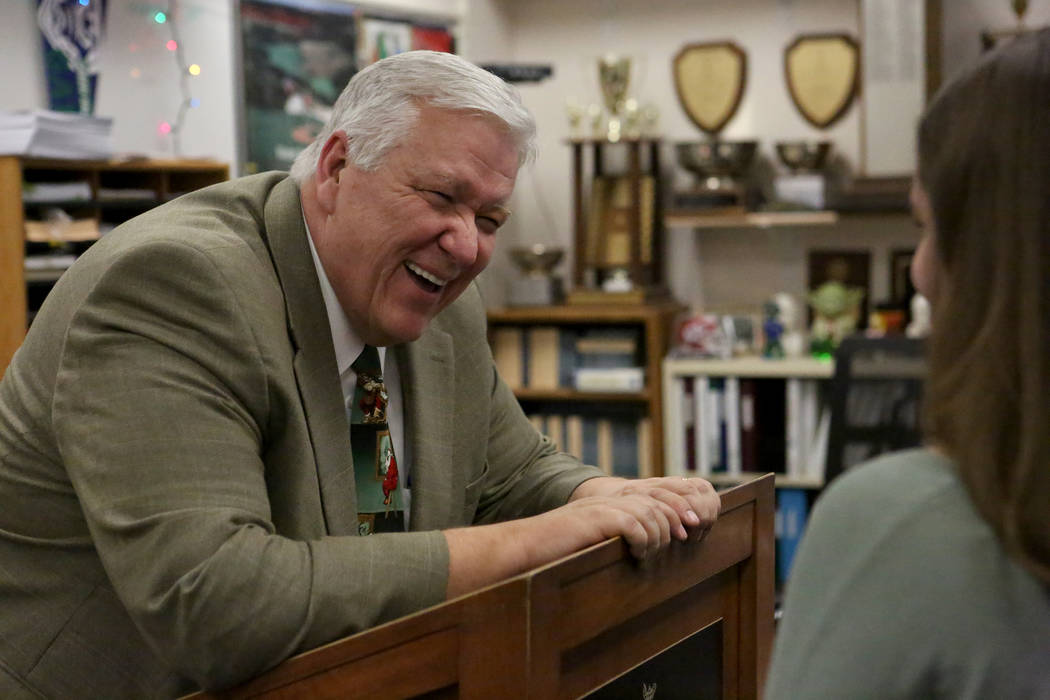 Green Valley High School teacher, Scott Ginger, who was selected as the Nevada Educator of the Year because of his unwavering commitment to speech and debate education, talks with former students  ...