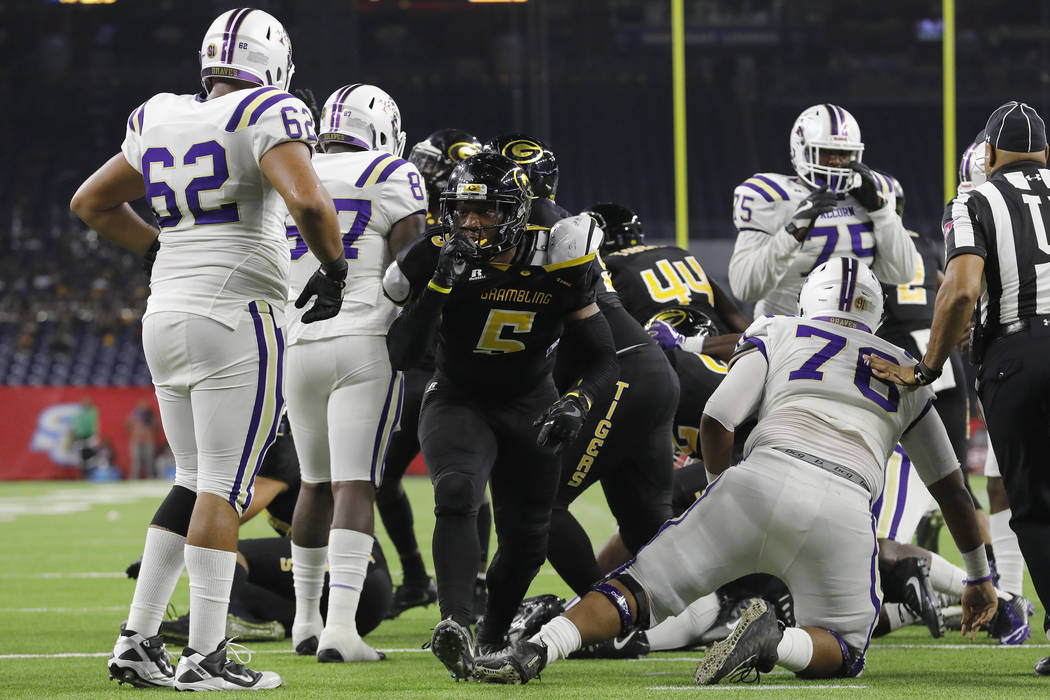 FILE - In this Dec. 2, 2017, file photo, Grambling State linebacker De'Arius Christmas (5) reacts after a fourth-down stop in the third quarter during the Southwestern Athletic Conference champion ...