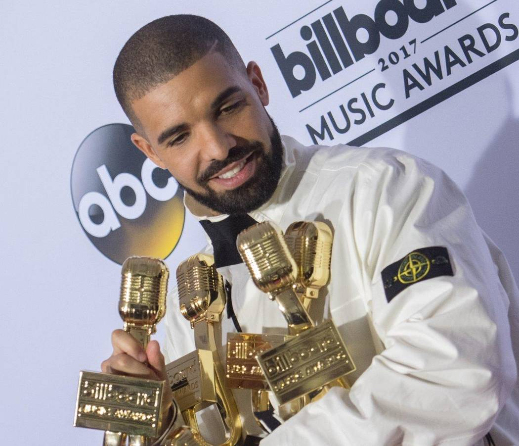 Drake holds his awards -- the rapper won a record 13 -- after the 2017 Billboard Music Awards at T-Mobile Arena on Sunday, May 21, 2017, in Las Vegas. (Tom Donoghue)