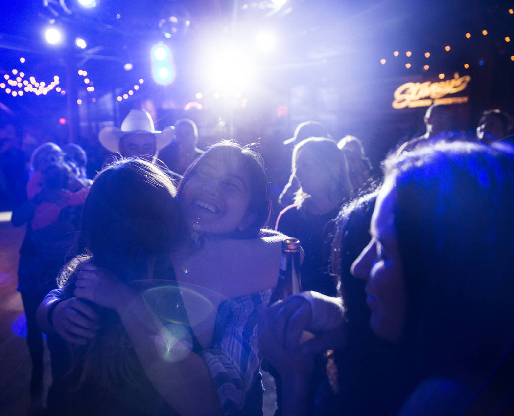 Reanne Pilapil, left, hugs a friend during a benefit show for the victims of the Route 91 shooting at Stoney's Rockin' Country on Wednesday, October 4, 2017, in Las Vegas.  Benjamin Hager Las Vega ...