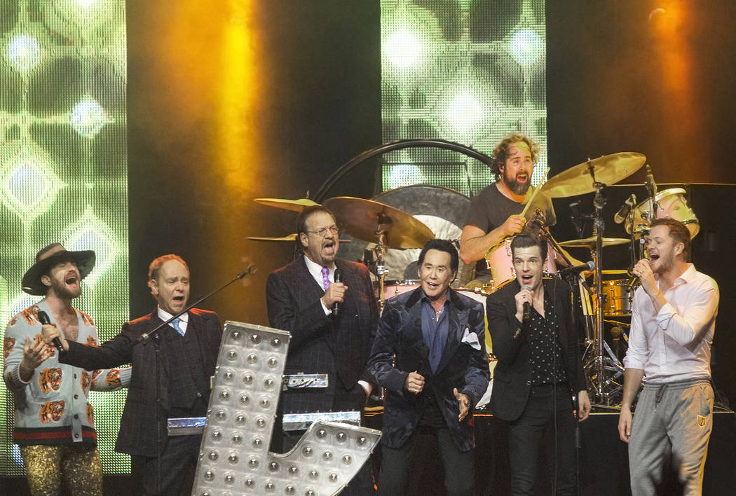 "Daniel Platzman, Teller, Penn Jillette, Wayne Newton, Brandon Flowers and Dan Reynolds sing ""Viva Las Vegas"" at the conclusion of the Vegas Strong Benefit Concert at T-Mobile Are ..."