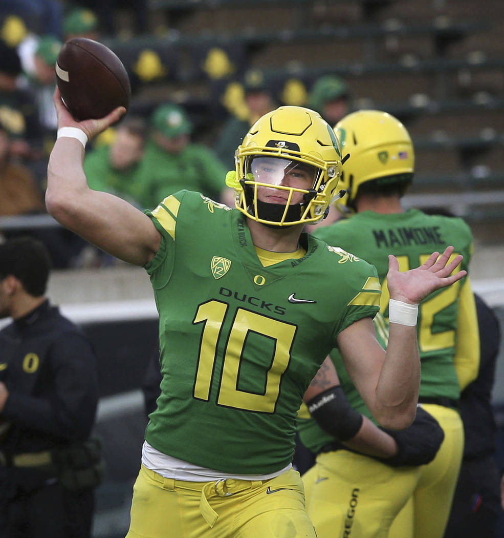 Oregon quarterback Justin Herbert warms up before the the team's NCAA college football game against Arizona on Saturday, Nov. 18, 2017, in Eugene, Ore. Herbert has been out with an injury. (AP Pho ...