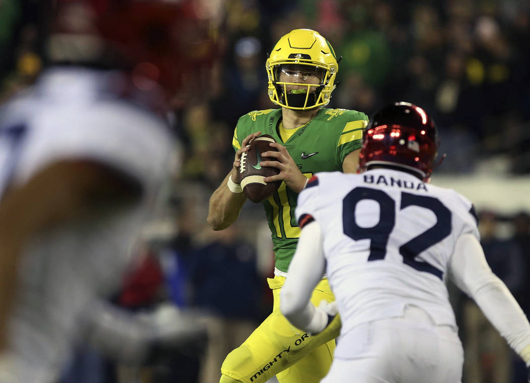 Oregon's quarterback Justin Herbert looks to pass down field against Arizona during the fourth quarter of an NCAA college football game, Saturday, Nov. 18, 2017, in Eugene, Ore. (AP Photo/Chris Pi ...