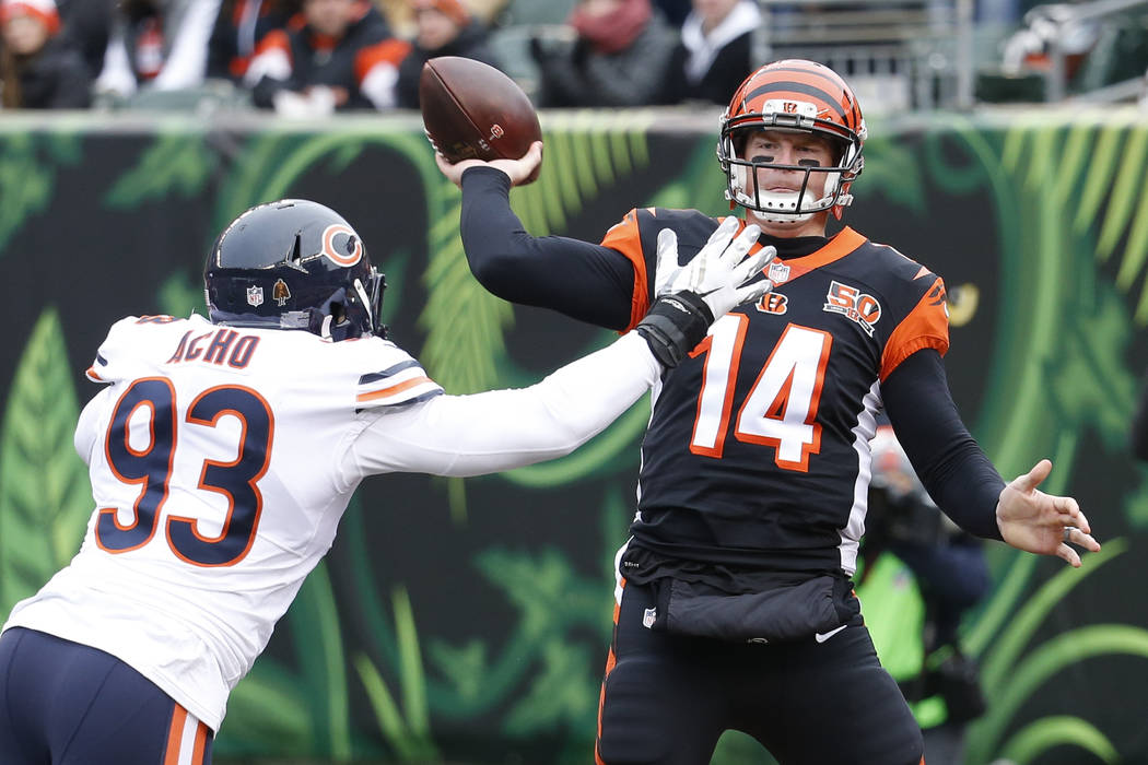 Cincinnati Bengals quarterback Andy Dalton (14) passes under pressure from Chicago Bears outside linebacker Sam Acho (93) in the first half of an NFL football game, Sunday, Dec. 10, 2017, in Cinci ...