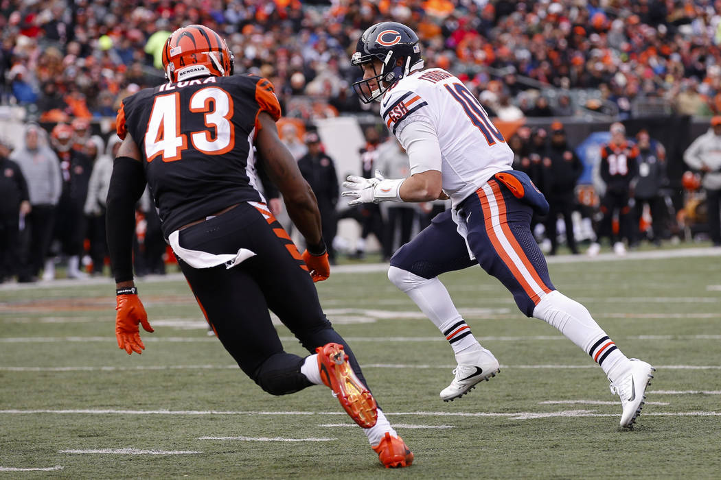 Chicago Bears quarterback Mitchell Trubisky (10) runs in for a touchdown against Cincinnati Bengals free safety George Iloka (43) in the second half of an NFL football game, Sunday, Dec. 10, 2017, ...