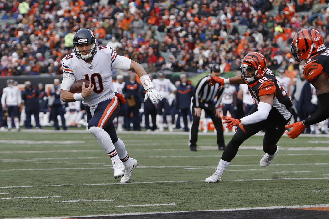 Chicago Bears quarterback Mitchell Trubisky (10) runs in for a touchdown against Cincinnati Bengals linebacker Jordan Evans (50) in the second half of an NFL football game, Sunday, Dec. 10, 2017,  ...