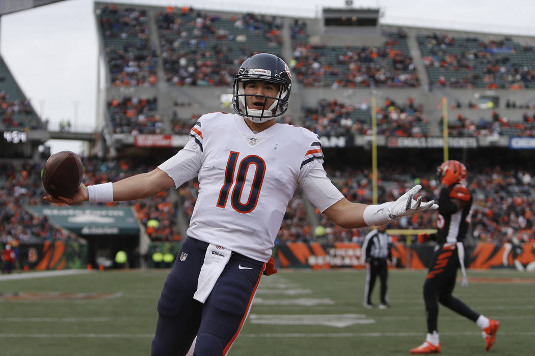 Chicago Bears quarterback Mitchell Trubisky celebrates after running in a touchdown in the second half of an NFL football game against the Cincinnati Bengals, Sunday, Dec. 10, 2017, in Cincinnati. ...